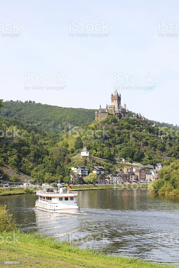 Excursion boat on river Mosel with Reichsburg castle in background royalty-free stock photo