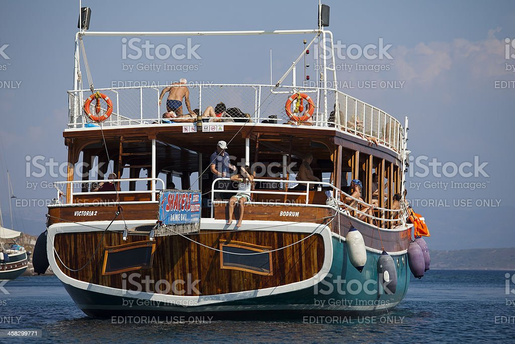 Excursion boat with Full of Tourists at Aegean Sea royalty-free stock photo