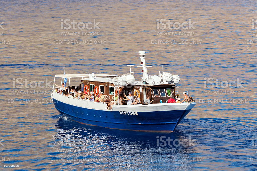 Excursion boat with tourists makes journey stock photo
