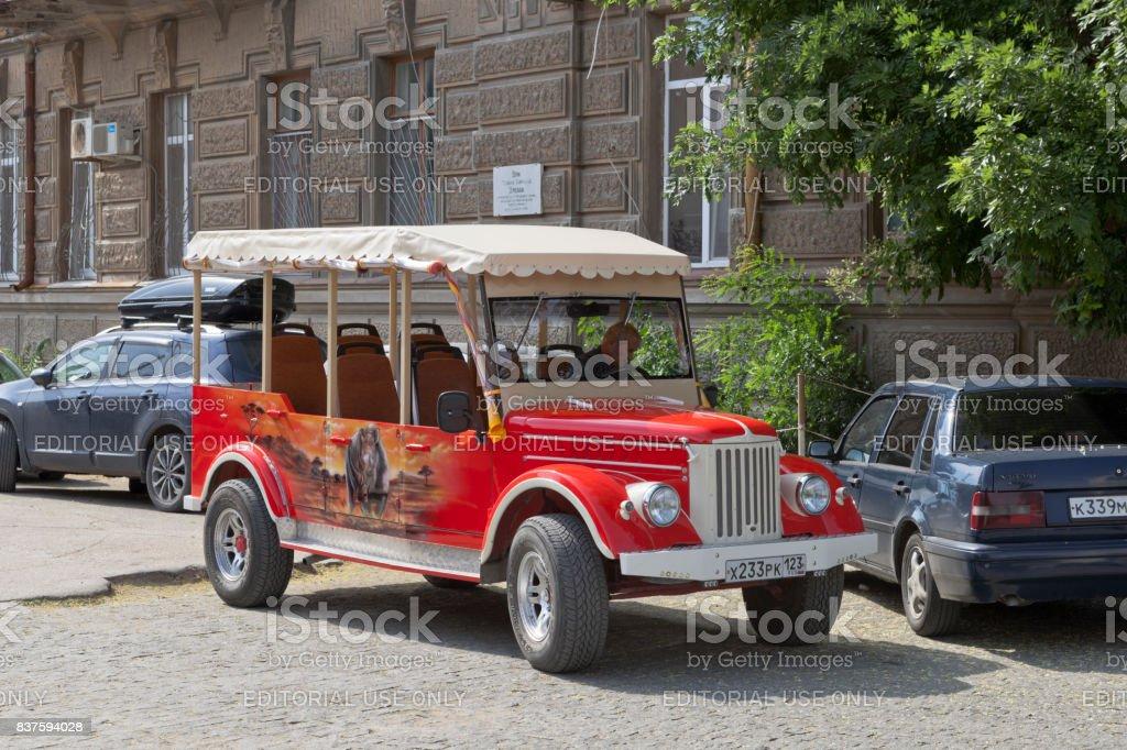 Excursion retro car on the basis of GAZ-69 near the house of Semyon Ezrovich Duvan in Evpatoria stock photo