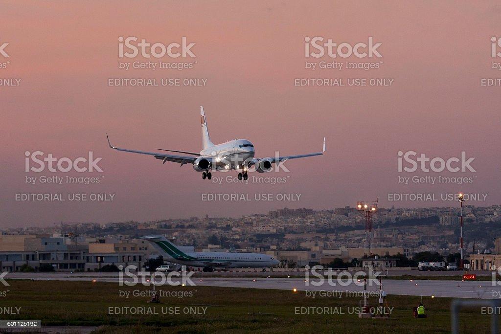 Executive 737-BBJ landing after sunset. stock photo