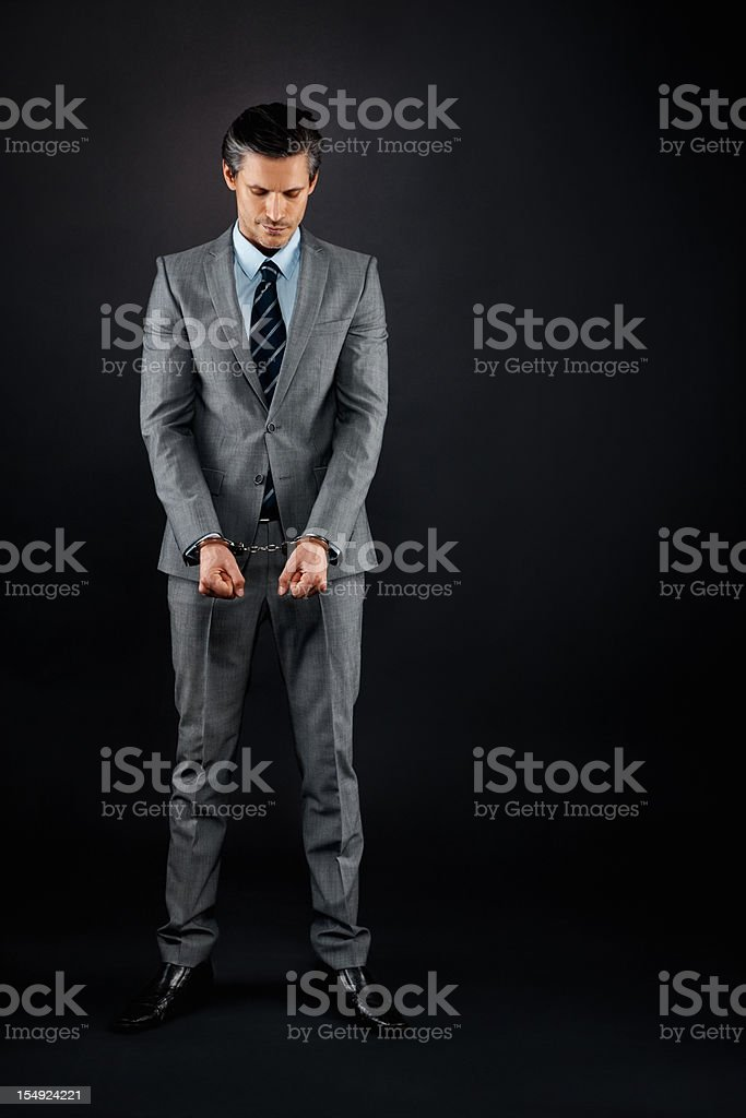 Executive being punished royalty-free stock photo