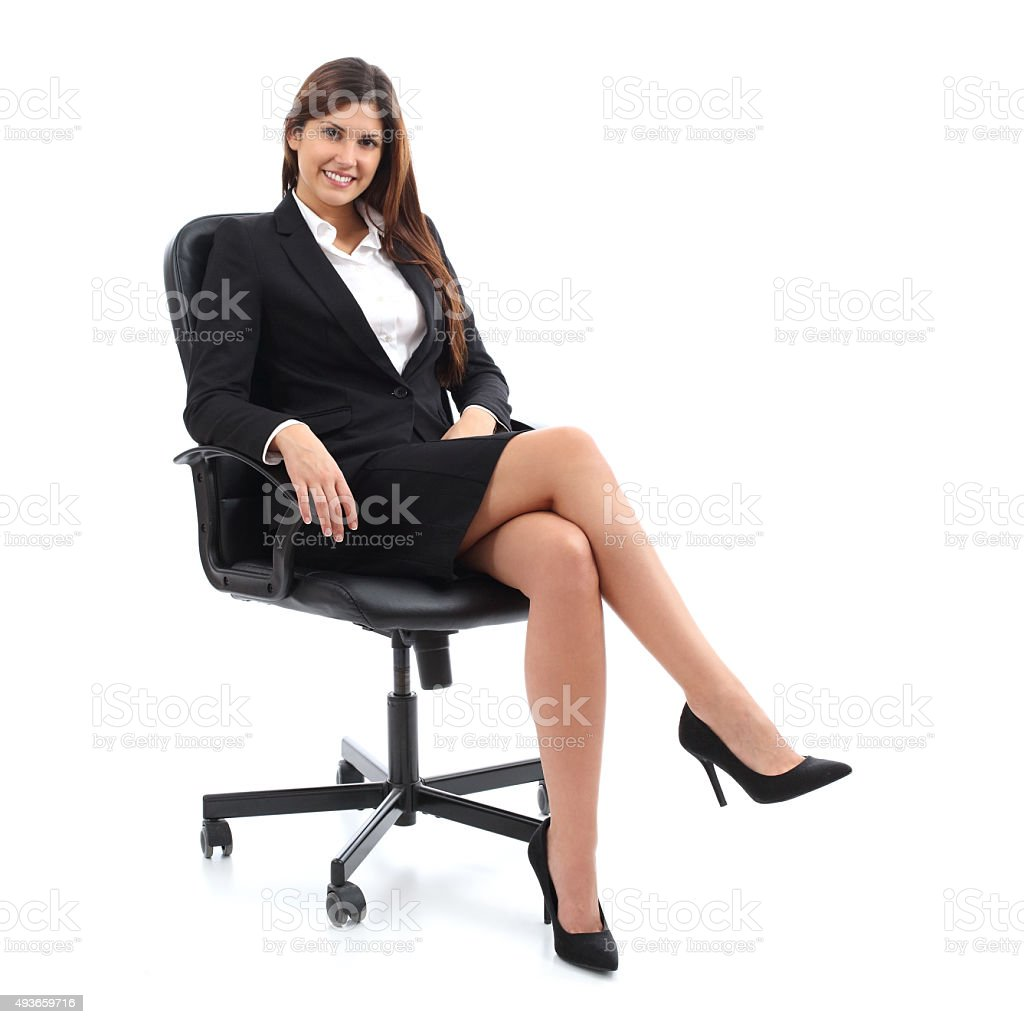 Executive business woman sitting on a chair stock photo