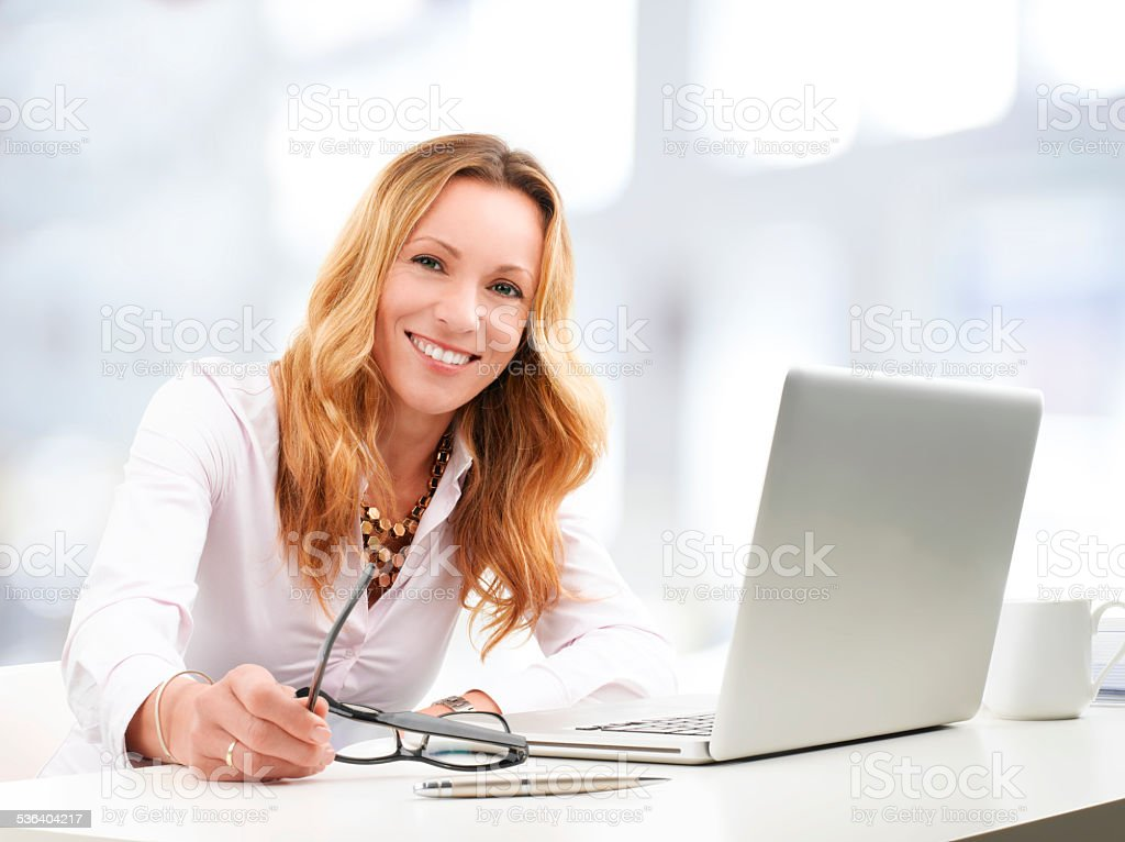 Executive business woman with laptop stock photo
