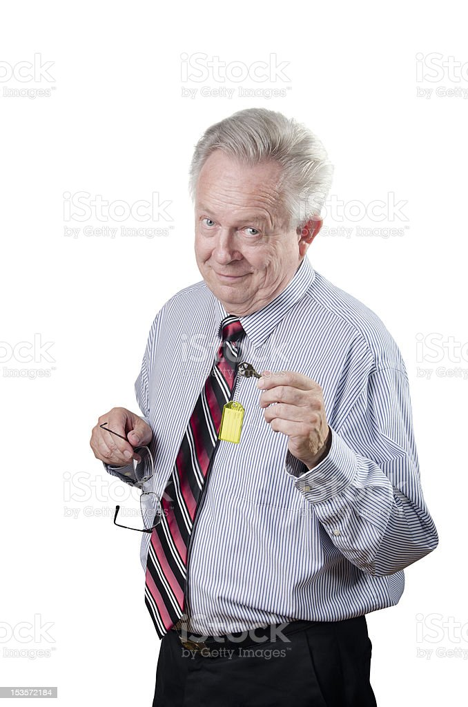 Executive Businessman Offering A House Office Or Room Key royalty-free stock photo