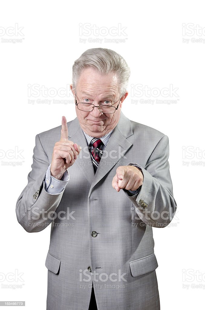 Executive Businessman Pointing To You And Giving Number One Gesture stock photo