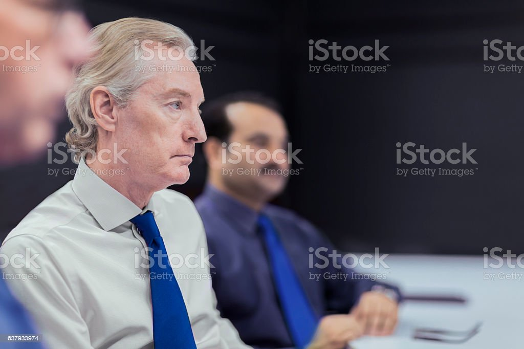 Executive businessmen in office meeting stock photo