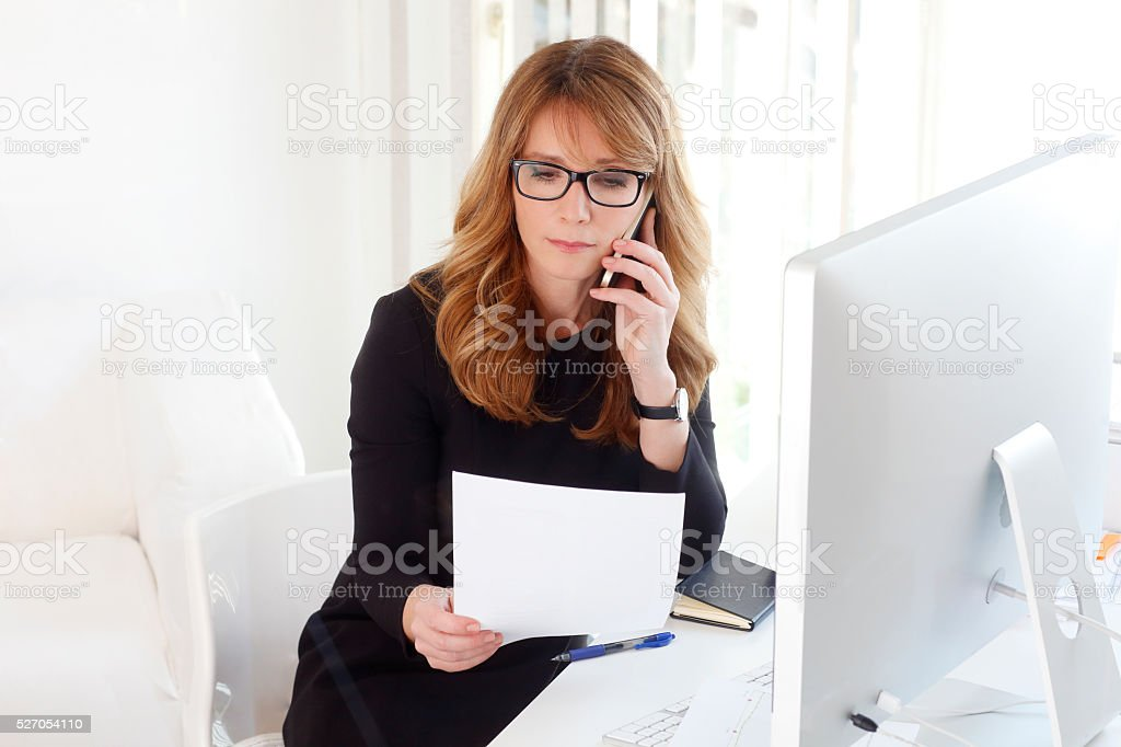 Executive businesswoman with mobile phone stock photo