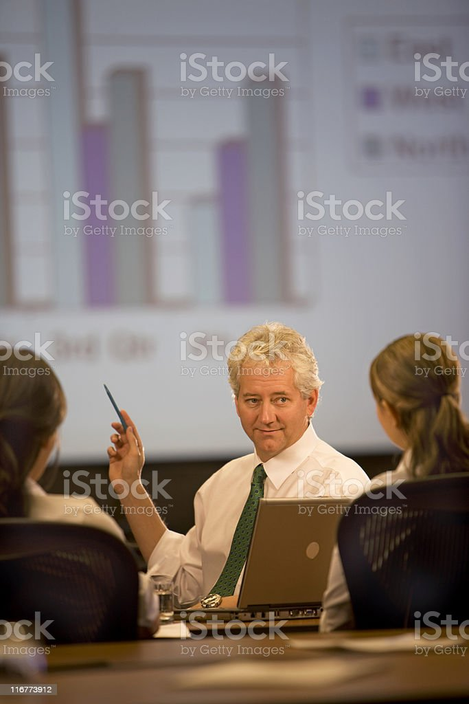 Executive Conducting A Meeting In His Office royalty-free stock photo