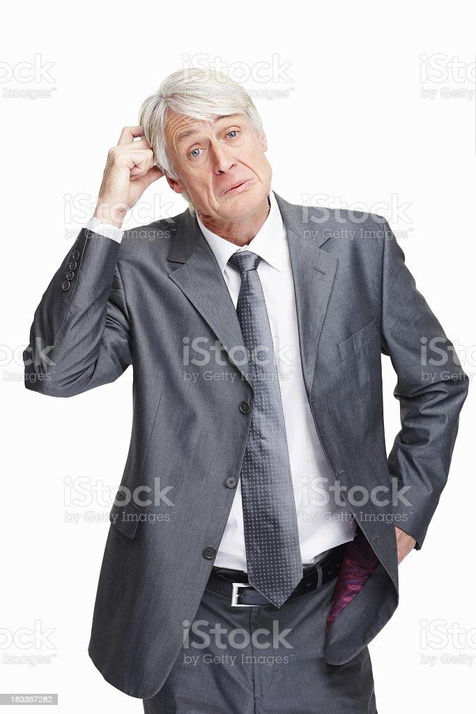 Executive contemplating big decision royalty-free stock photo