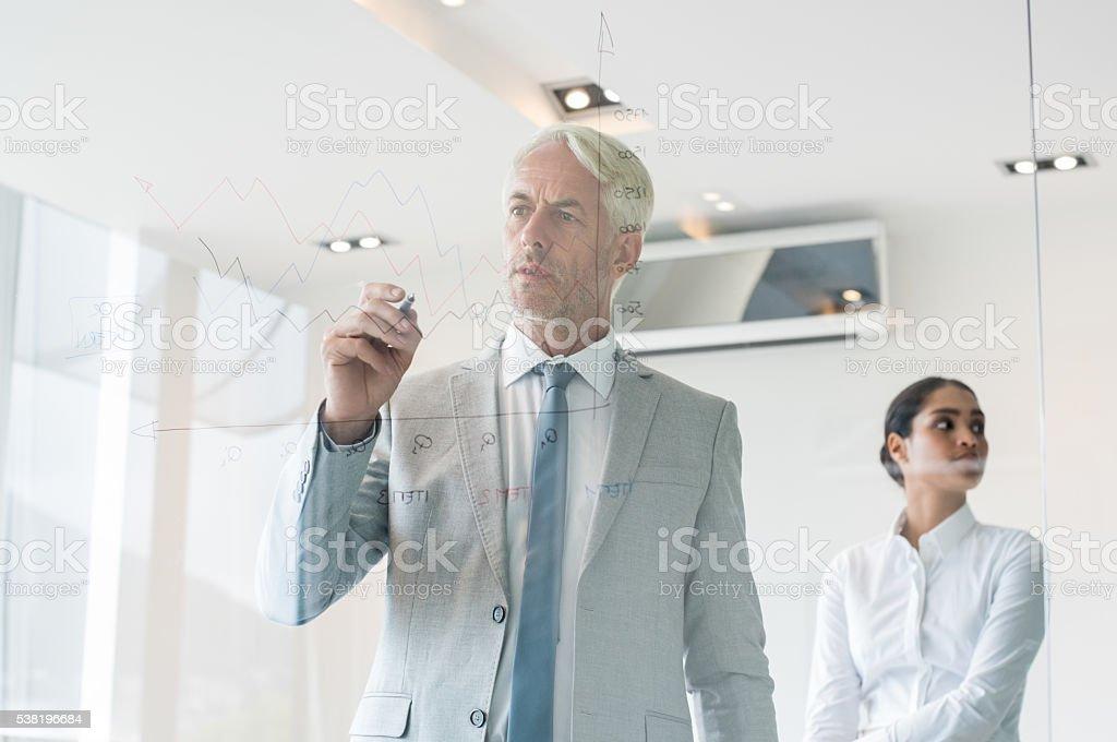 Executive drawing graph stock photo