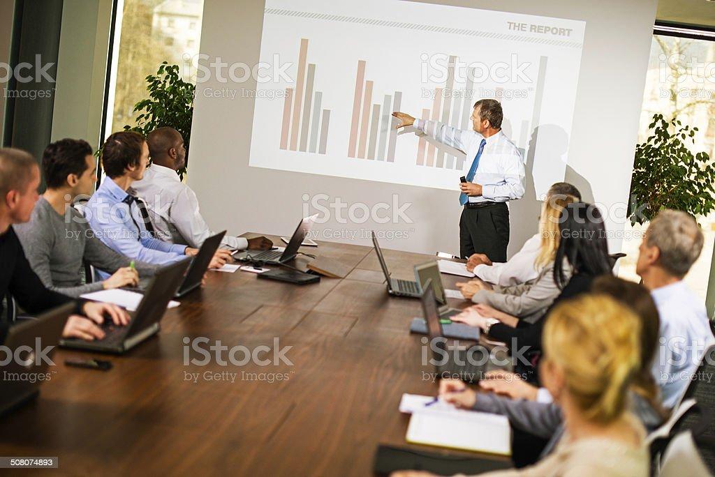 Executive Explaining Graph stock photo