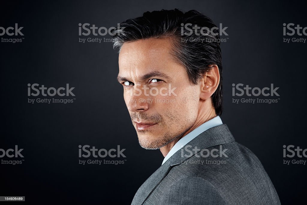 Executive glaring over his shoulder royalty-free stock photo