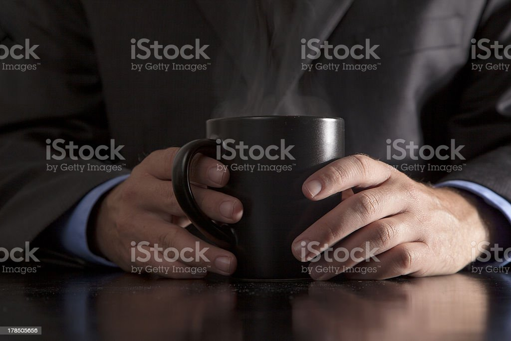 Executive Holds Steaming Coffee royalty-free stock photo