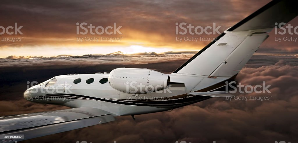 Executive in flight at sunset stock photo
