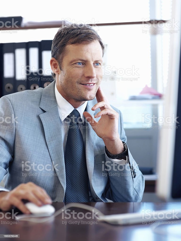 Executive looking concentrated at a computer royalty-free stock photo