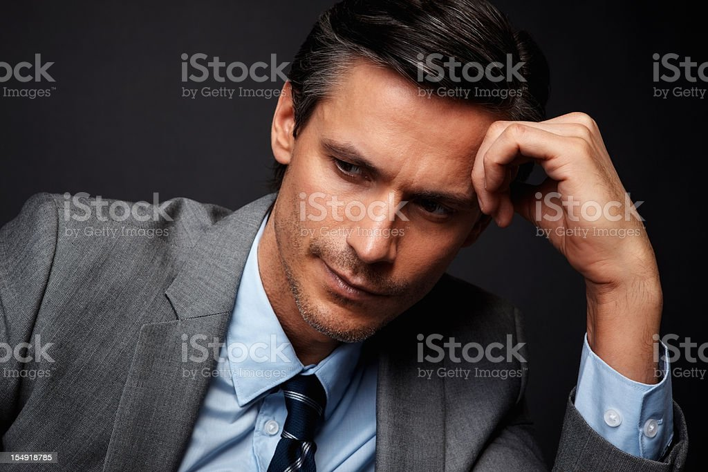 Executive looking thoughtful royalty-free stock photo