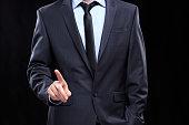 executive man touching an imaginary screen