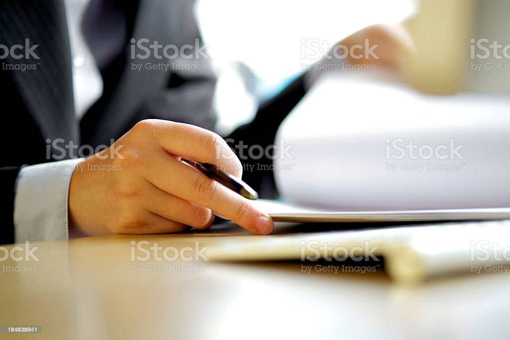 Executive man writing documents stock photo