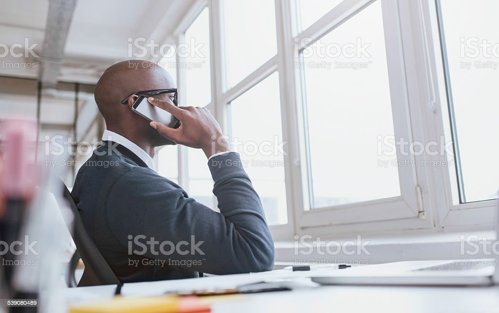 Executive on phone while at work stock photo