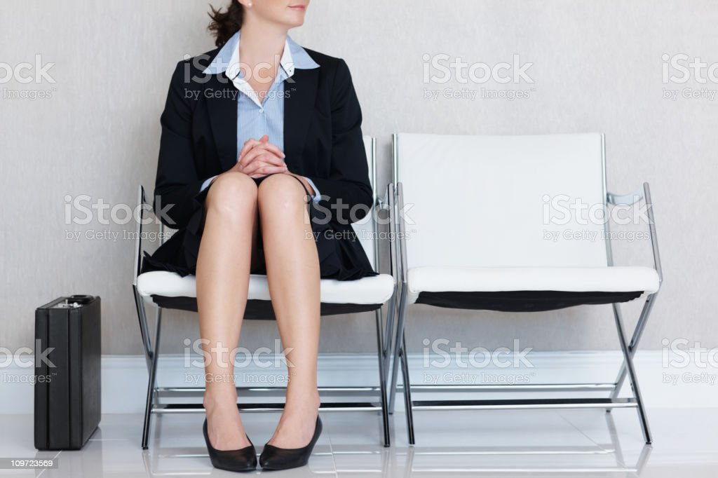Executive sitting on chair with briefcase at the office lounge stock photo