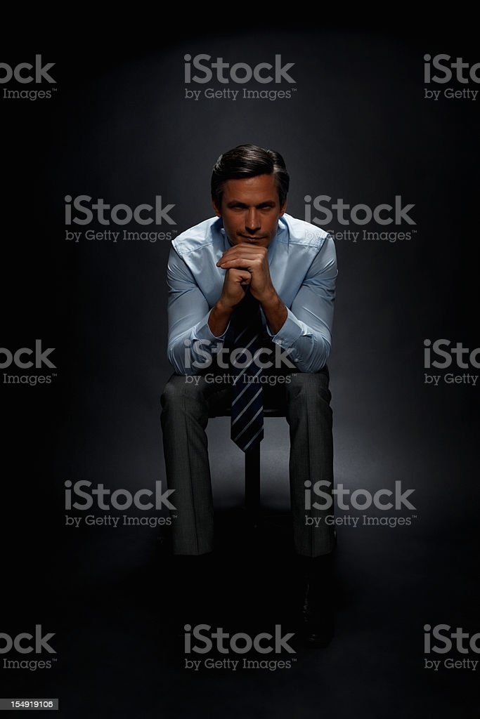 Executive sitting with serious look royalty-free stock photo