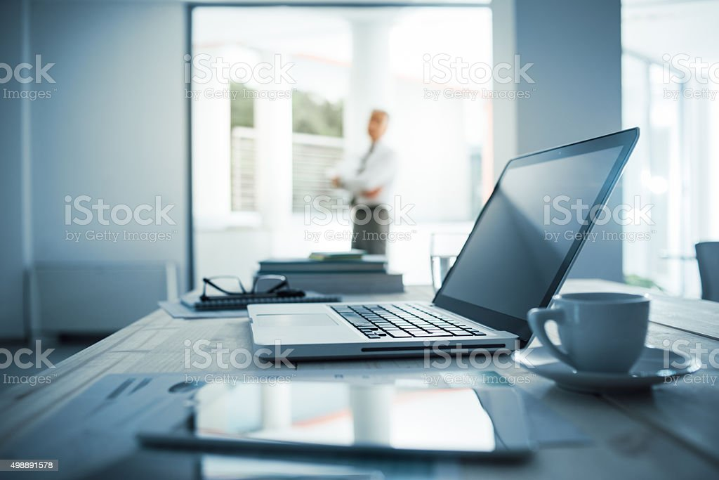 Executive standing in his office stock photo