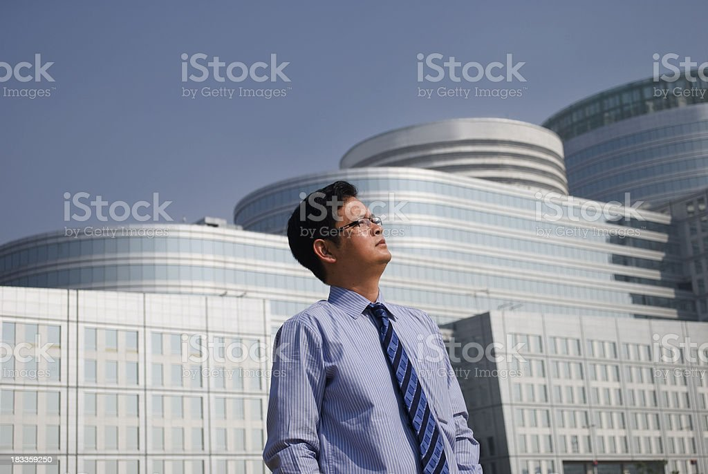 executive standing in-front of building stock photo