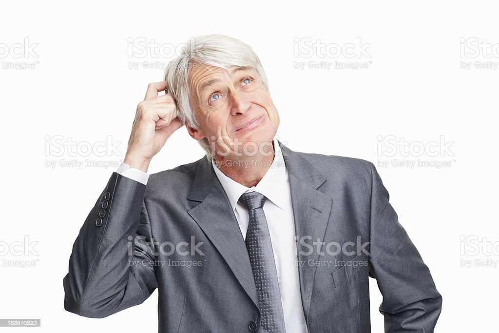 Executive struggling to make a decision royalty-free stock photo