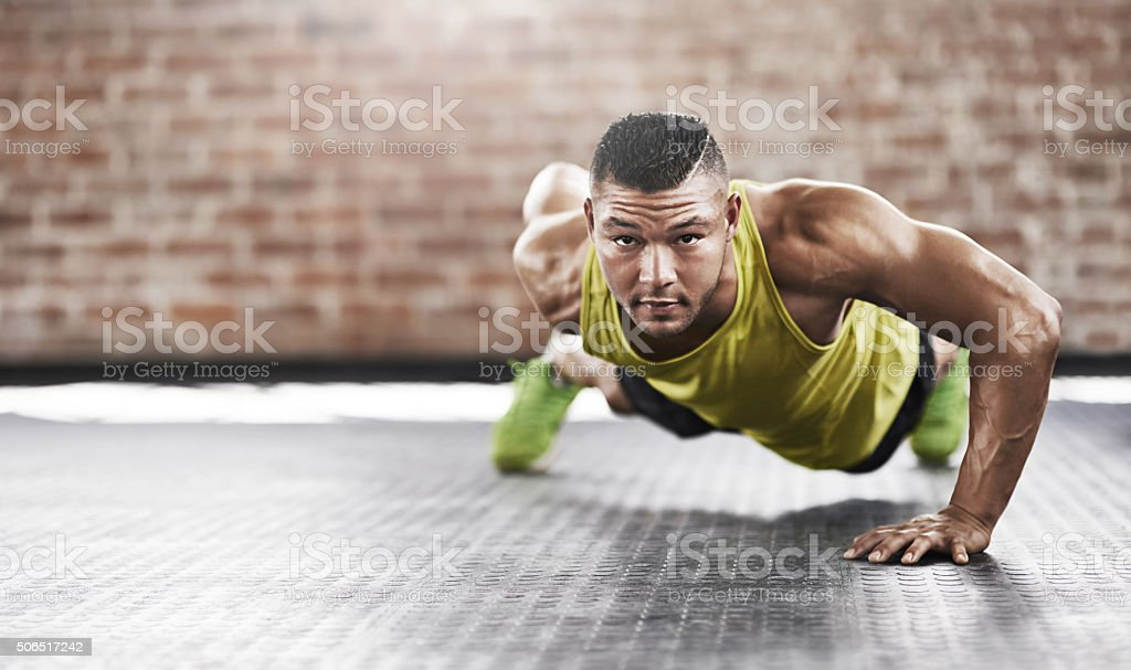 Executive the perfect one-handed pushup stock photo