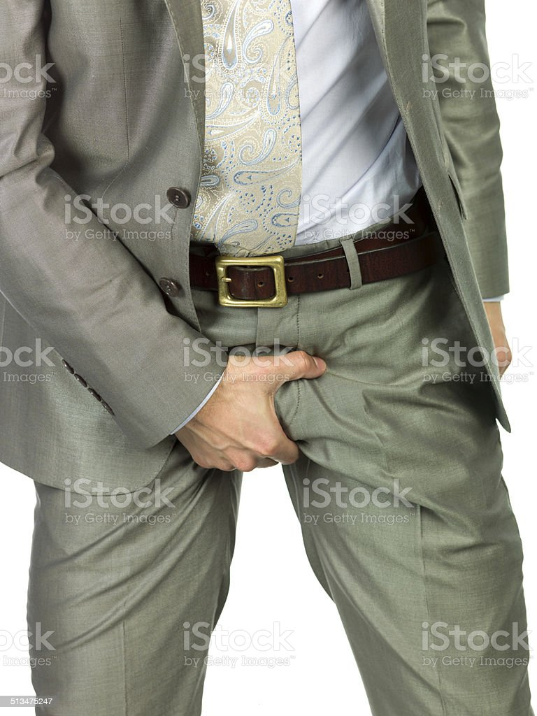 Executive Touching his testicles and penis stock photo