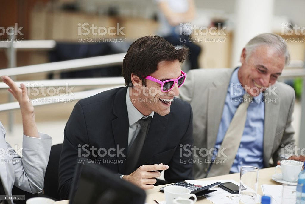 Executive wearing pink framed sunglasses to a meeting royalty-free stock photo