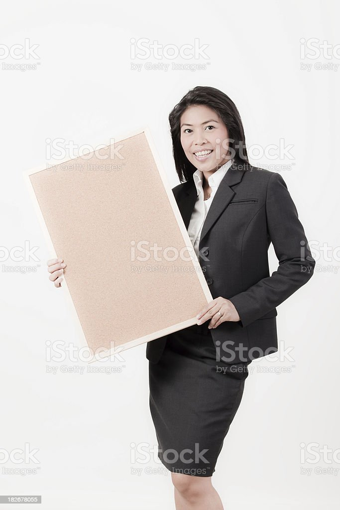 Executive with cork board royalty-free stock photo