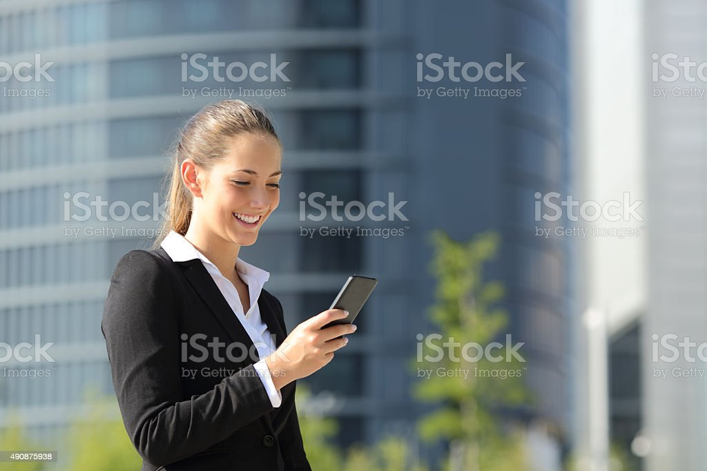 Executive working with a mobile phone stock photo