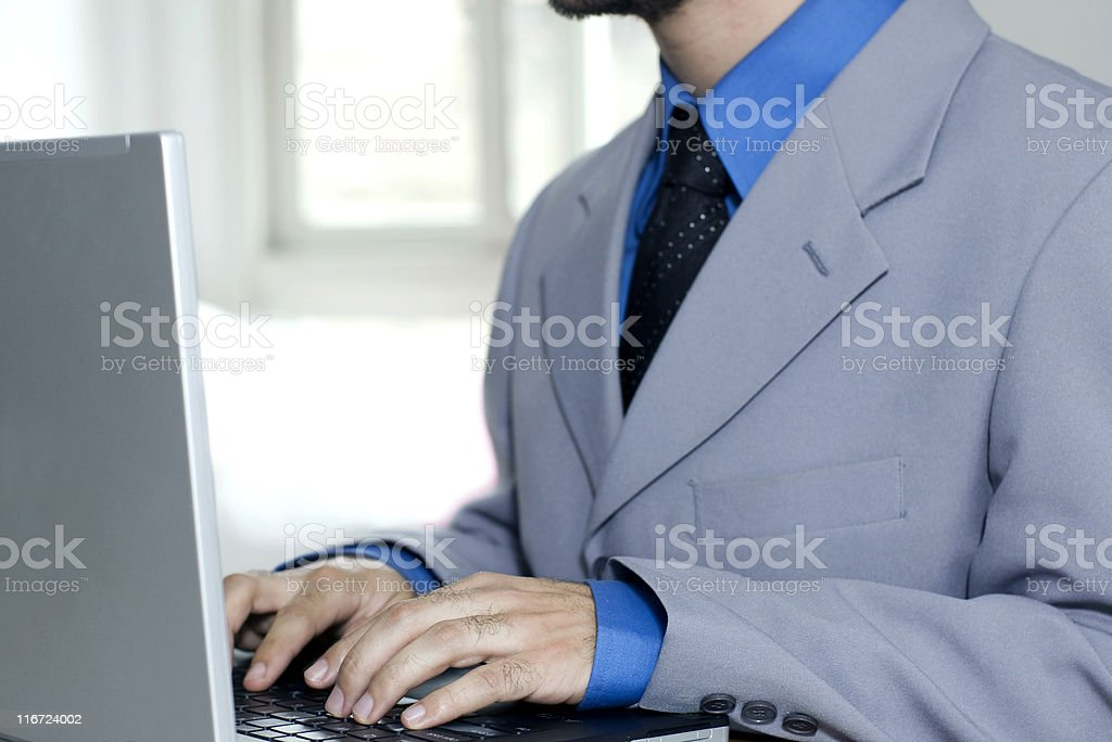 Executive working with laptop royalty-free stock photo