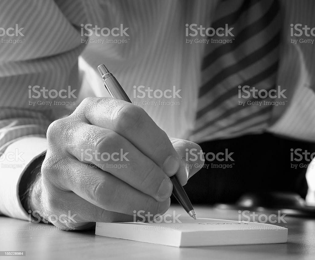 Executive writing notes royalty-free stock photo