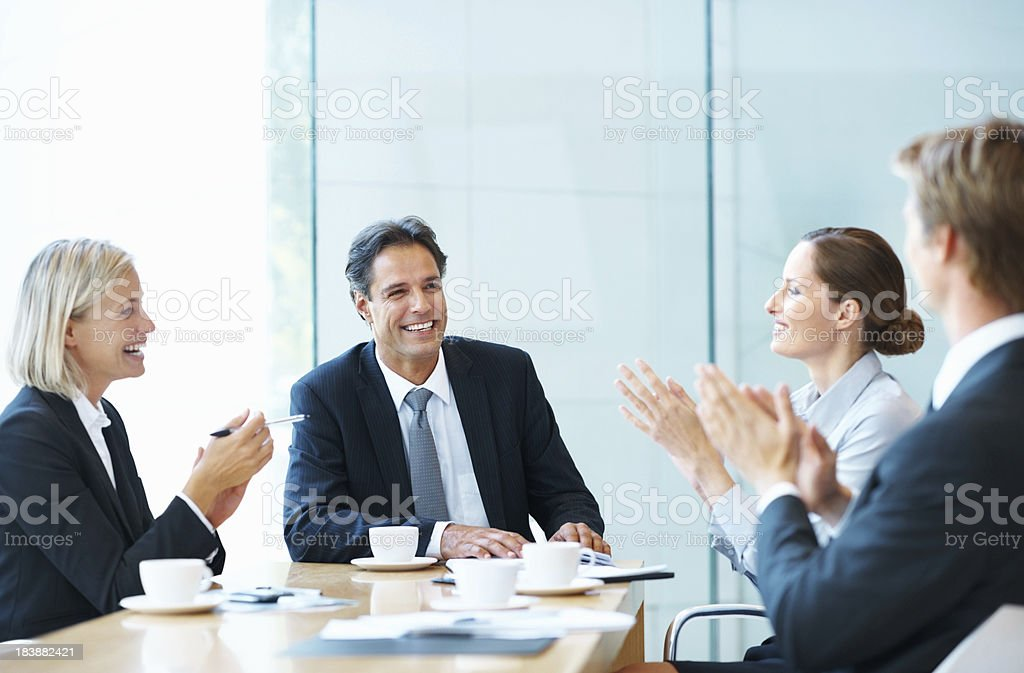 Executives applauding during a meeting royalty-free stock photo