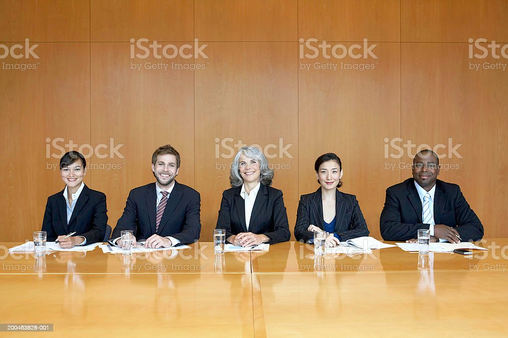 Executives at conference table, portrait royalty-free stock photo