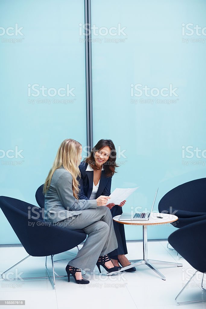Executives conversing over documents royalty-free stock photo