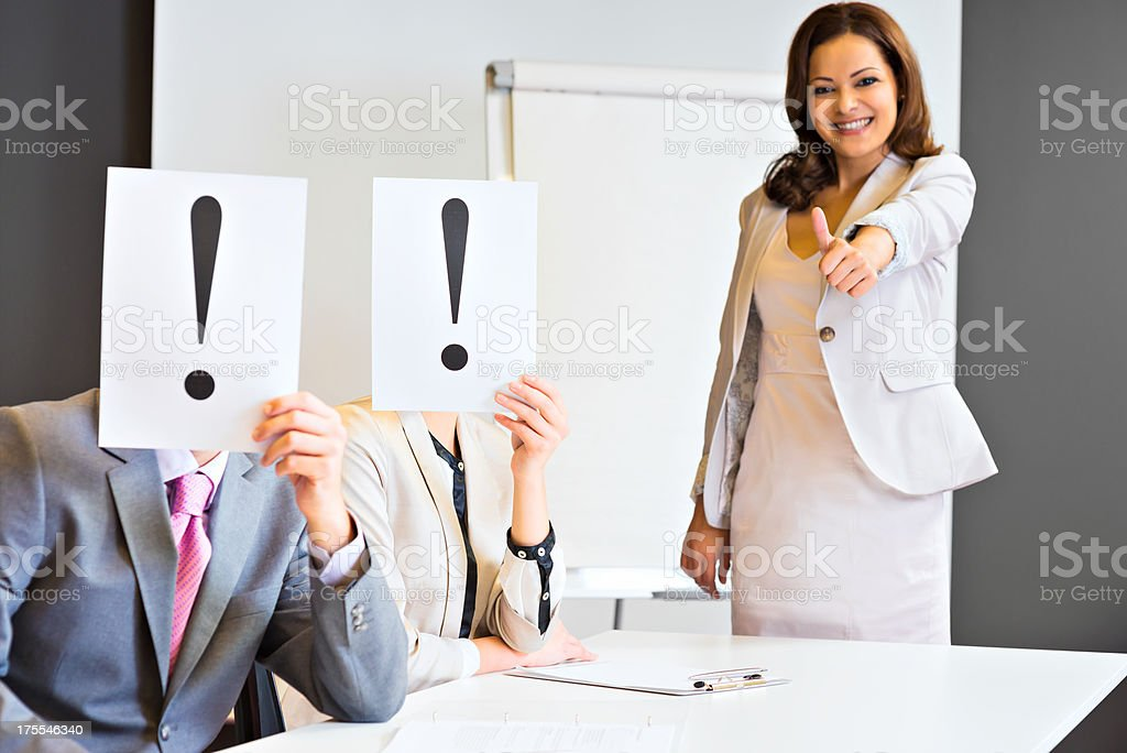 Executives covering their faces with exclamation mark royalty-free stock photo