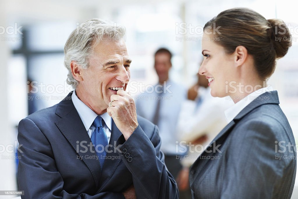 Executives discussing with colleague in background royalty-free stock photo