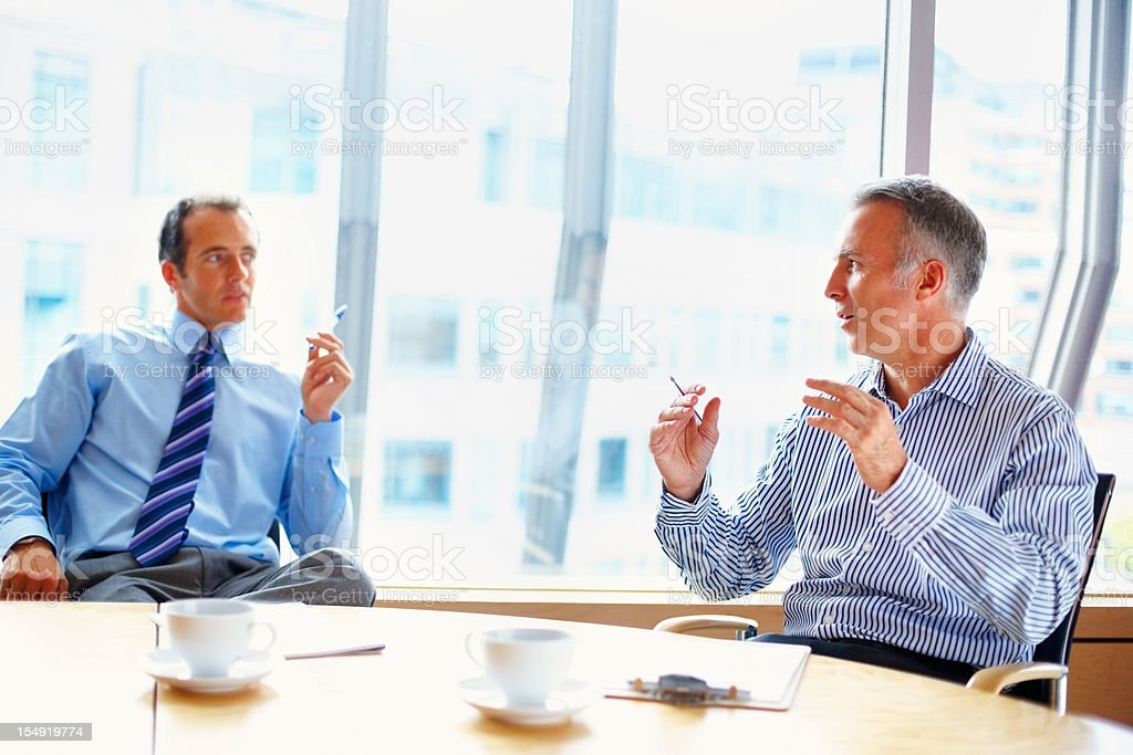 Executives having conversation at table royalty-free stock photo