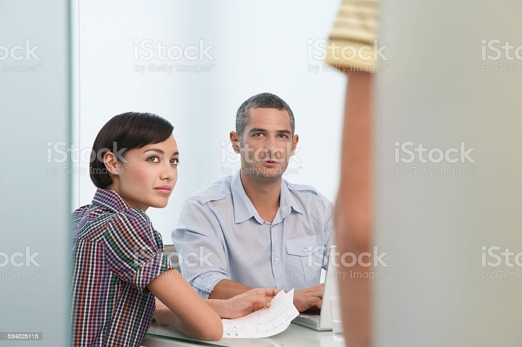 Executives Looking At Cropped Coworker stock photo