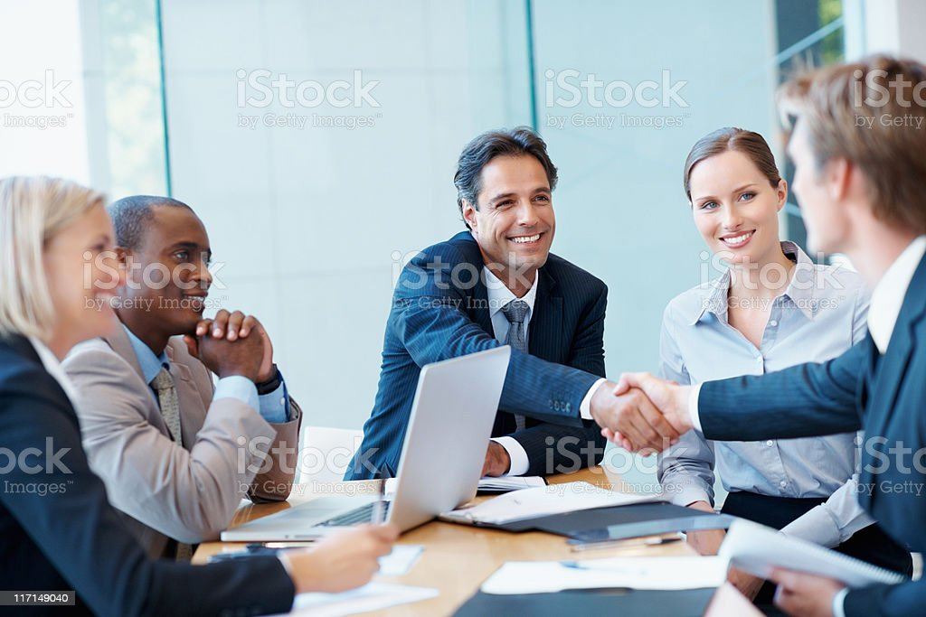 Executives shaking hands royalty-free stock photo