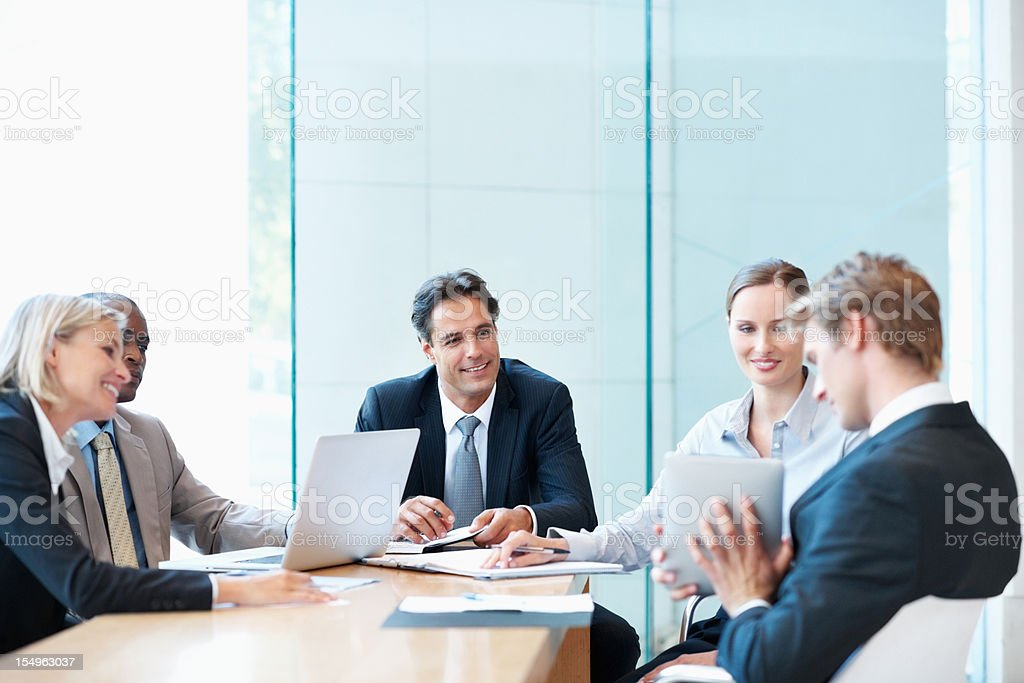 Executives sitting at table during a meeting royalty-free stock photo