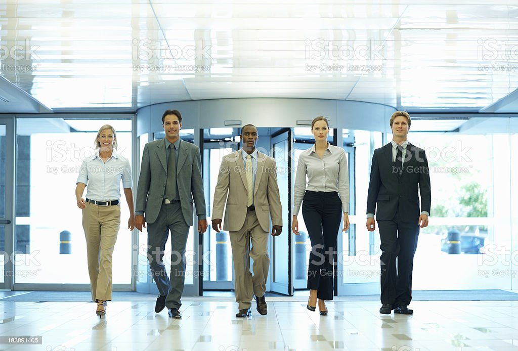Executives walking in a line royalty-free stock photo