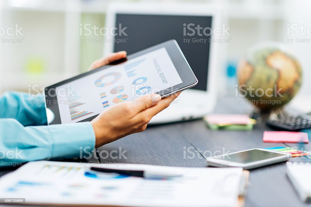 Exeprt analyzing financial reports and investment opportunities stock photo
