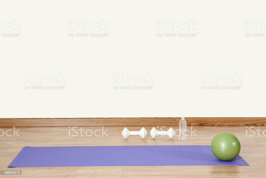 Exercise Ball and Yoga Mat stock photo