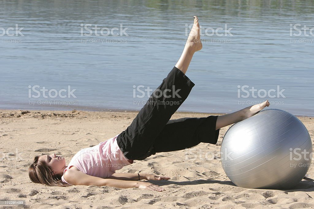 Exercise Ball Leg Lift stock photo