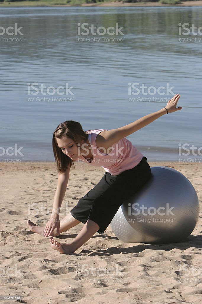 Exercise Ball Toe Touch 3rd of 3 stock photo